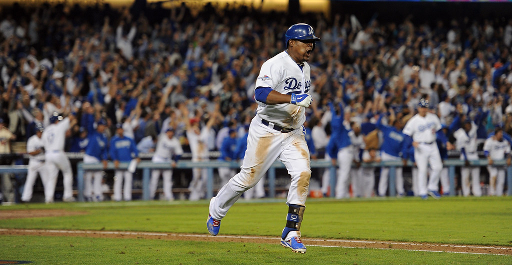 . The Dodgers\'  Juan Uribe rounds the bases on his bottom of the 8th 2 run homer against the Atlanta Braves during game 4 of the NLDS at Dodger Stadium Monday, October 7, 2013. The Dodgers beat the Braves 4-3.(Photo by Hans Gutkencht/Los Angeles Daily News)