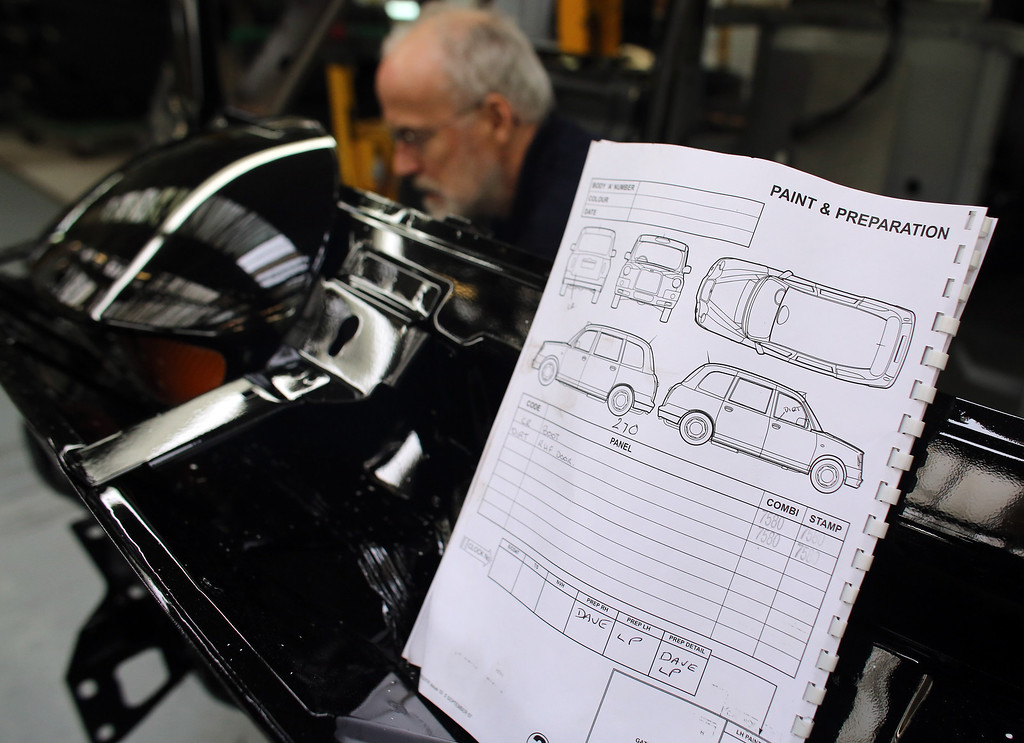 . TX4 (Euro 5) London Taxi is worked on the assembly line at The London Taxi Company factory on September 11, 2013 in Coventry, England.  (Photo by Matt Cardy/Getty Images)
