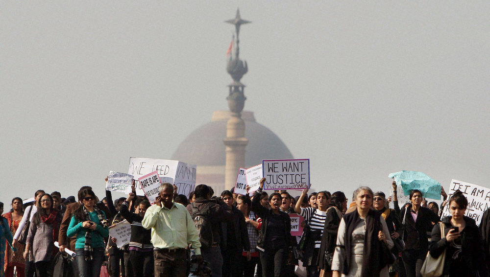 Description of . Activists of the All India Democratic Womenís Association and Young Womenís Christian Association (YWCA) and other people shout slogans as they take part in a protest march from the Presidential Palace to India Gate in New Delhi, India, Friday, Dec. 21, 2012. The gang-rape and beating of a 23-year-old student by six men on a bus in New Delhi triggered outrage and anger across the country for the fifth day in a row, as Indians demanded action from authorities who have long ignored persistent violence and harassment against women. (AP Photo)
