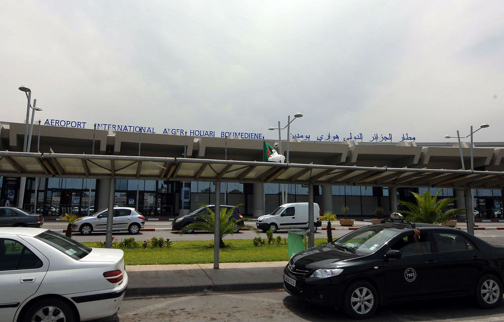 ". Vehicles are parked outside the Houari Boumedienne international airport near Algiers, Algeria, Thursday, July 24, 2014. An Air Algerie flight carrying 116 people from Burkina Faso to Algeria\'s capital disappeared from radar early Thursday over northern Mali and ""probably crashed\"" according to the plane\'s owner and government officials in France and Burkina Faso. (AP Photo/Sidali Djarboub)"