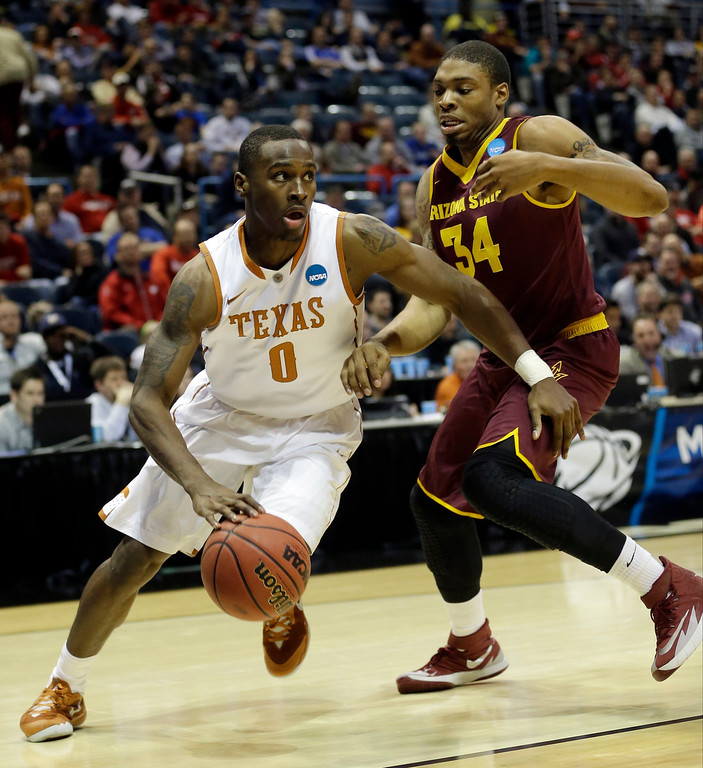 . Texas guard Kendal Yancy (0) drives the ball against Arizona State guard Jermaine Marshall (34) during the second half of a second-round game in the NCAA college basketball tournament Thursday, March 20, 2014, in Milwaukee. (AP Photo/Morry Gash)