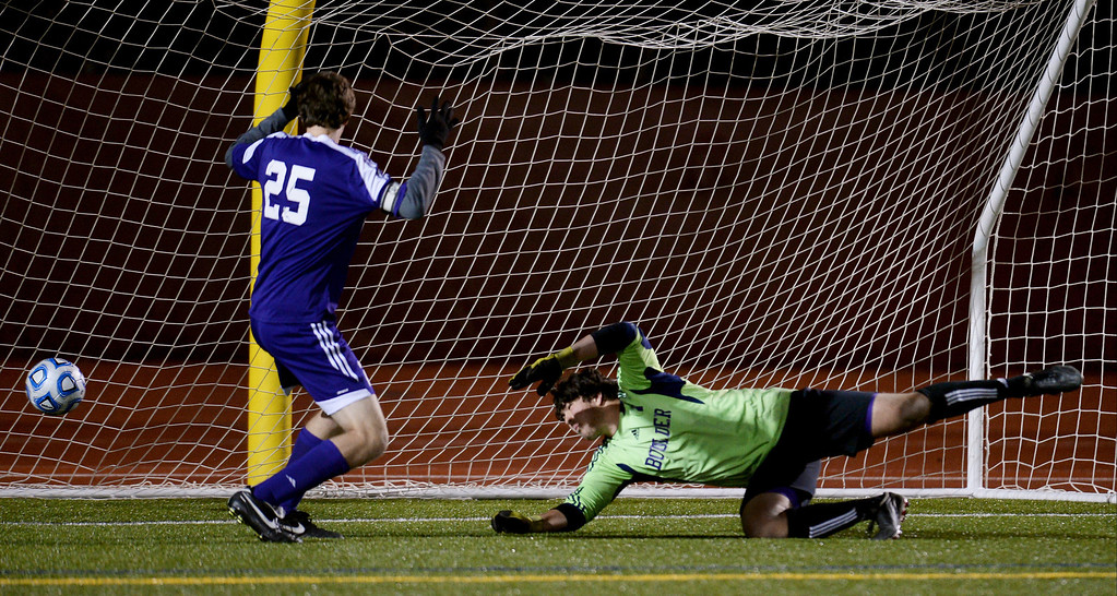 . The ball kicked by Alexander Cullen of Pine Creek gets past goaltender Henry Huettel of Boulder High School (1), right, and Ryan Bower (25) in overtime at Legacy Stadium in Aurora, Colorado, on November 6, 2013. Pine Creek won 1-0 in overtime. (Photo by Hyoung Chang/The Denver Post)