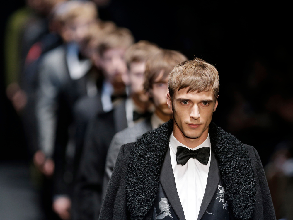 Description of . Models wear creations for Gucci men's Fall-Winter 2013-14 collection, part of the Milan Fashion Week, unveiled in Milan, Italy, Monday, Jan. 14, 2013. (AP Photo/Antonio Calanni)