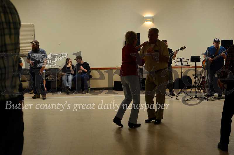 Ron Meyers and Joline McClure slow dance together during a break between square dance sets at the Harrisville Volunteer Fire Company's January square dance. Tanner Cole/Butler Eagle