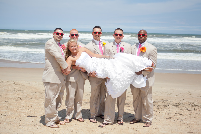 This destination wedding was photographed in Nags Head North Carolina by Ranson Photography.  Robert Ranson is a professional Richmond wedding photographer who photographs weddings all throughout Virginia as well as destination weddings.