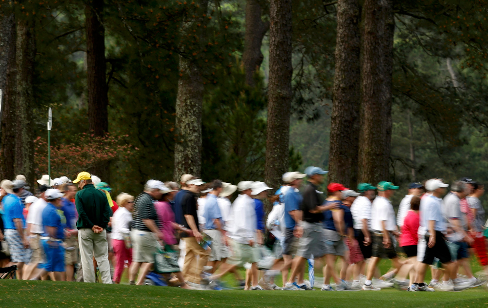 Description of . Patrons make their way down the second fairway during second round play in the 2013 Masters golf tournament at the Augusta National Golf Club in Augusta, Georgia, April 12, 2013.  REUTERS/Mark Blinch