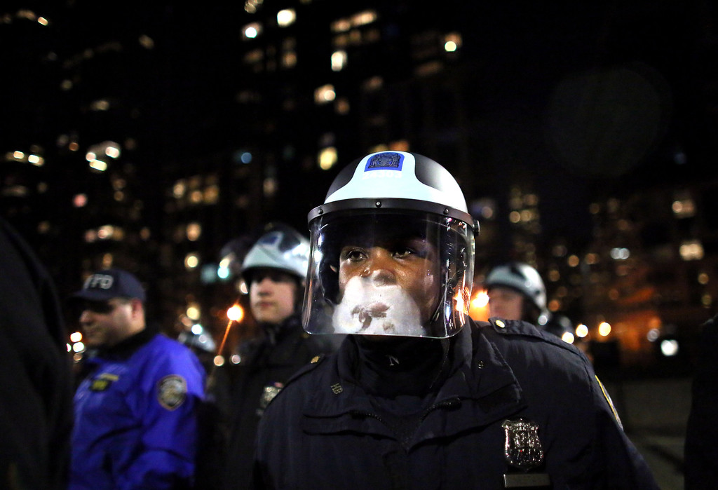 . Police watch protesters on the West Side Highway December 3, 2014 in New York. Protests began after a Grand Jury decided to not indict officer Daniel Pantaleo. Eric Garner died after being put in a chokehold by Pantaleo on July 17, 2014. Pantaleo had suspected Garner of selling untaxed cigarettes. (Photo by Yana Paskova/Getty Images)