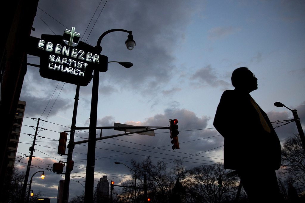 . A man walks past Ebenezer Baptist Church, early Monday, Jan. 16, 2017, in Atlanta, where the late civil rights leader Martin Luther King Jr. preached. (AP Photo/Branden Camp)