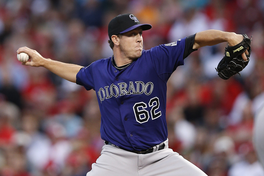 . Rob Scahill #62 of the Colorado Rockies pitches against the Cincinnati Reds during the game at Great American Ball Park on June 3, 2013 in Cincinnati, Ohio. The Reds won 3-0. (Photo by Joe Robbins/Getty Images)