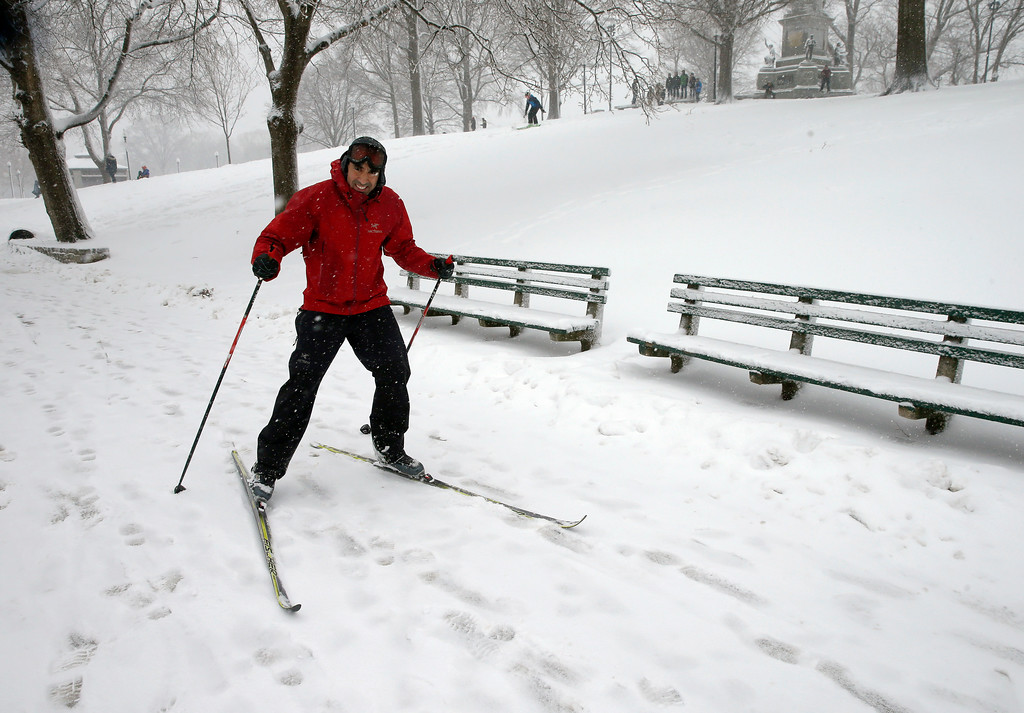 . A cross-country skier glides through a snowstorm, Tuesday, March 13, 2018, in Boston. (AP Photo/Michael Dwyer)