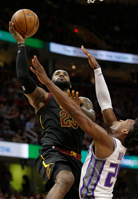 . Cleveland Cavaliers\' LeBron James (23) drives to the basket against Sacramento Kings\' Buddy Hield (24), from the Bahamas, in the first half of an NBA basketball game, Wednesday, Dec. 6, 2017, in Cleveland. (AP Photo/Tony Dejak)