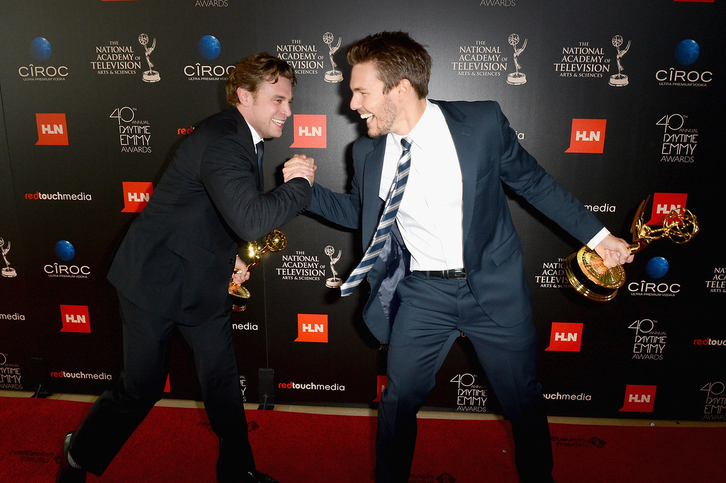 """. Actors Billy Miller (L) and Scott Clifton pose with the Outstanding Supporting Actor in a Drama Series award for \""""The Young and the Restless\"""" and \""""The Bold and the Beautiful\"""" in the press room during The 40th Annual Daytime Emmy Awards at The Beverly Hilton Hotel on June 16, 2013 in Beverly Hills, California.  (Photo by Mark Davis/Getty Images)"""