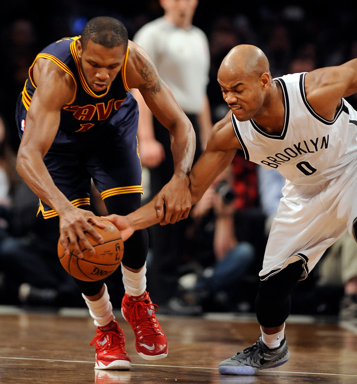 . Cleveland Cavaliers forward James Jones (1) and Brooklyn Nets guard Jarrett Jack (0) battle for a loose ball in the second half of an NBA basketball game on Friday, March 27, 2015, in New York. The Nets won 106-98. (AP Photo/Kathy Kmonicek)