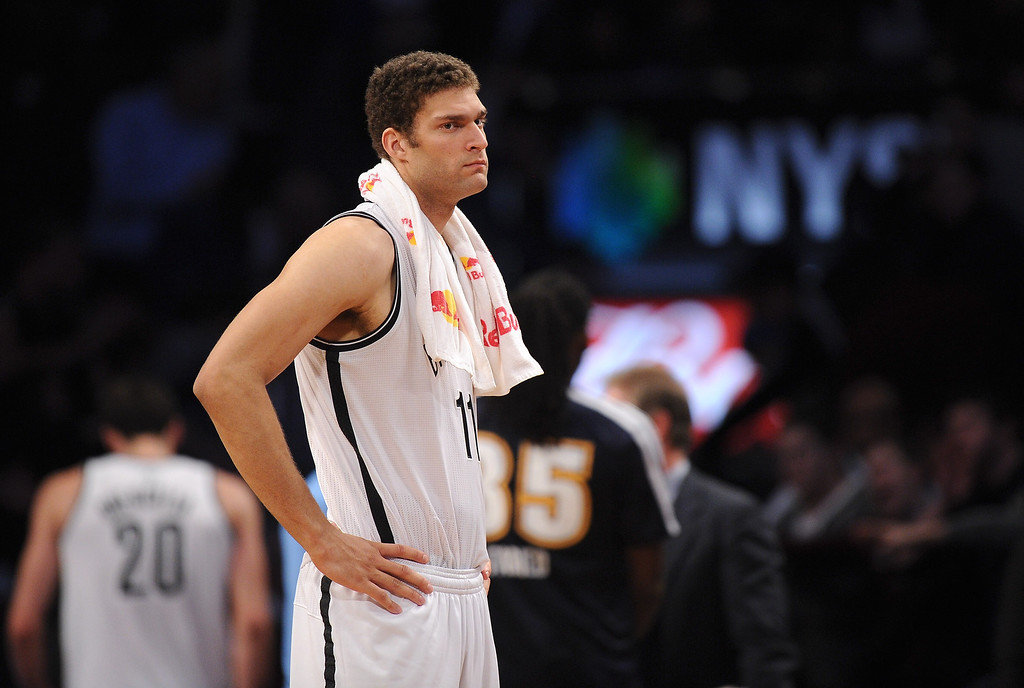 . NEW YORK, NY - DECEMBER 03:  Brook Lopez #11 of the Brooklyn Nets looks on during the second half against the Denver Nuggets at Barclays Center on December 3, 2013 in the Brooklyn borough of New York City. The Nuggets defeat the Nets 111-87. (Photo by Maddie Meyer/Getty Images)