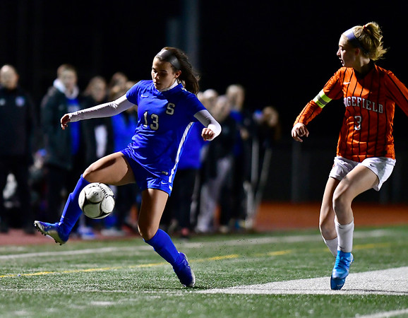 11/19/2019 Mike Orazzi | StaffrSouthington High School's Maya Wroblewski (13)) and Ridgfield's Carolyn Donovan (3) during the Class LL Semifinal Girls Soccer match at Naugatuck High School Tuesday night. Southington advanced to the final 1-0.r