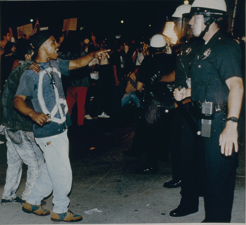 . Demonstrators got in the face of police officers at Parker Center, the headquarters for the Los Angeles Police Department. Later, rioters destroyed a guard shack and set it on fire in the middle of the street.April 29, 1992. (Photo by John McCoy/Los Angeles Daily News).
