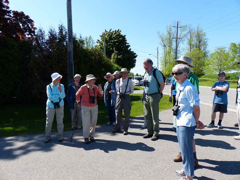 Margaret Bain and other WBFN members gathered at entrance from Thickson Road leading to Thickson's Woods.
