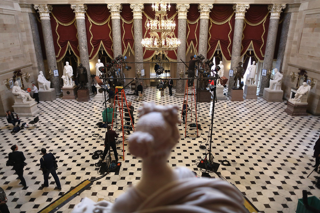 . WASHINGTON, DC - JANUARY 28:  Television lighting technicians build sets inside Statuary Hall for post-speech interviews hours before U.S. President Barack Obama delivers the State of the Union address to a joint session of Congress at the U.S. Capitol on January 28, 2014 in Washington, DC. In his fifth State of the Union address, Obama is expected to emphasize healthcare, economic fairness and new initiatives designed to stimulate the U.S. economy with bipartisan cooperation.  (Photo by Chip Somodevilla/Getty Images)