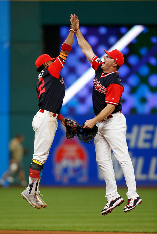 . Cleveland Indians\' Jay Bruce, right, and Francisco Lindor celebrate a 4-0 victory over the Kansas City Royals in a baseball game, Saturday, Aug. 26, 2017, in Cleveland. (AP Photo/Ron Schwane)