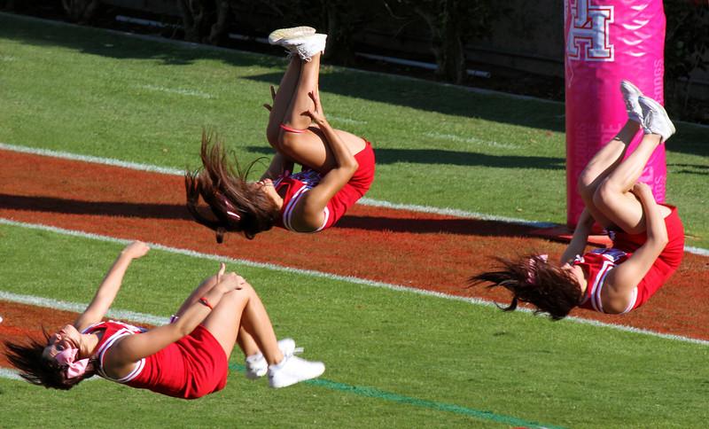 Cheerleaders doing celebratory backflips
