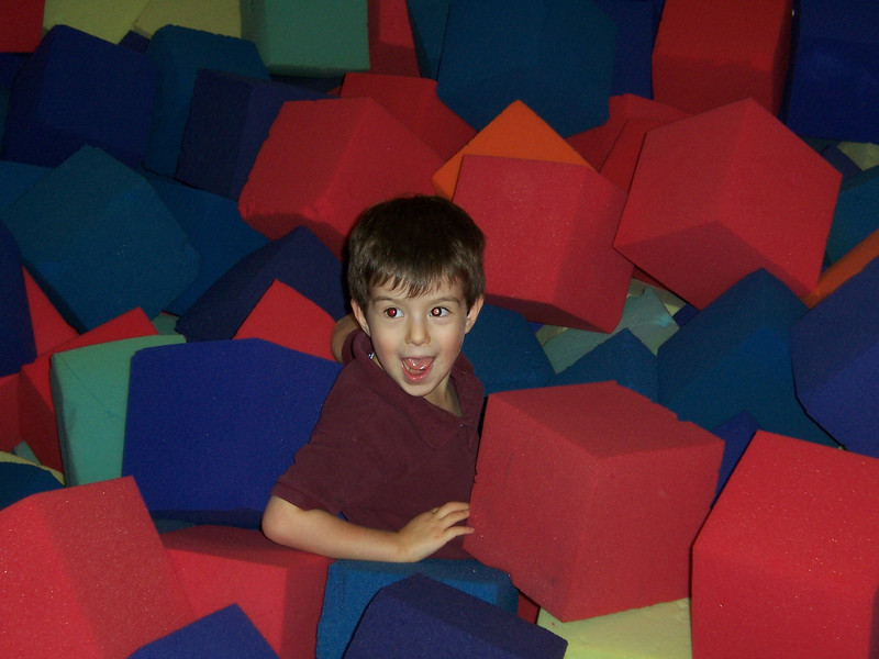 Aaron playing in the foam blocks.
