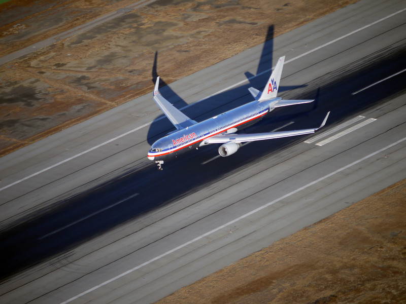 A plane coming in for a landing below us at SFO as we cruised right above.