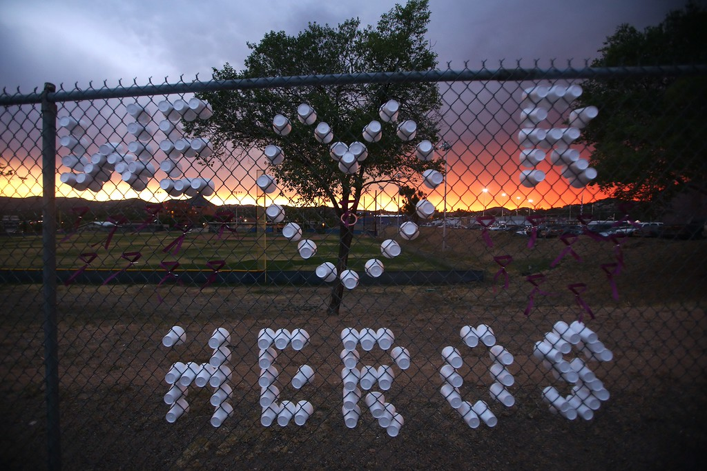 . A sign that reads \'We love R Heros\' is displayed outside a vigil and memorial gathering at the Prescott High School in Prescott, Arizona on July 2, 2013.    AFP PHOTO / Krista Kennell/AFP/Getty Images