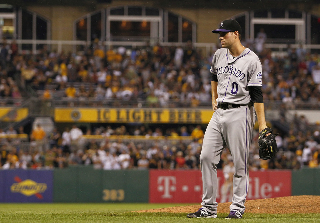 . PITTSBURGH, PA - JULY 18:  Adam Ottavino #0 of the Colorado Rockies looks on in the seventh inning after Starling Marte #6 of the Pittsburgh Pirates (not pictured) took a pitch to the head during the game at PNC Park July 18, 2014 in Pittsburgh, Pennsylvania.  (Photo by Justin K. Aller/Getty Images)