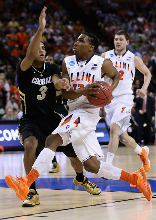 . AUSTIN, TX - MARCH 22:  Tracy Abrams #13 of the Illinois Fighting Illini goes up to the hoop past Xavier Talton #3 of the Colorado Buffaloes during the second round of the 2013 NCAA Men\'s Basketball Tournament at The Frank Erwin Center on March 22, 2013 in Austin, Texas.  (Photo by Stephen Dunn/Getty Images)