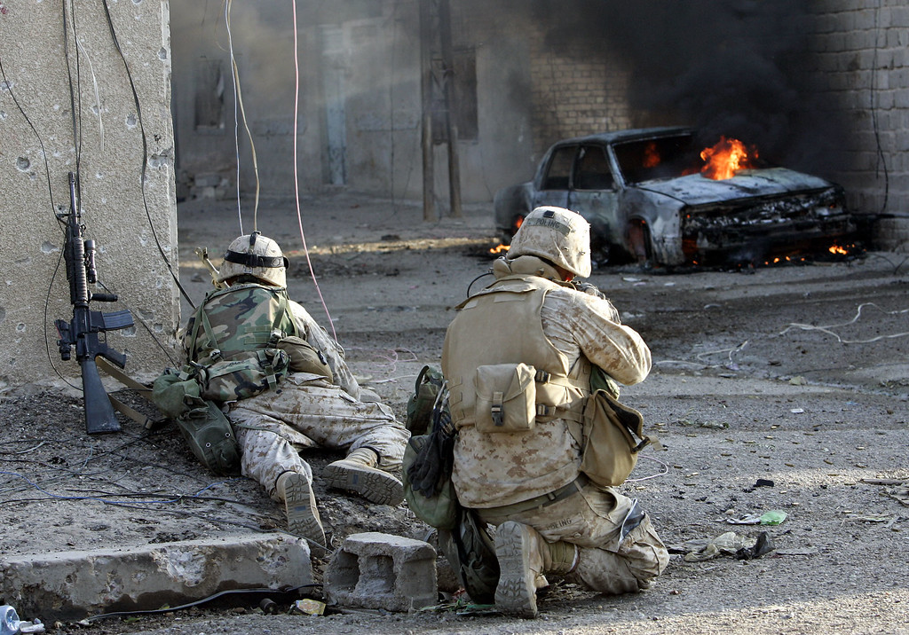 . US Marines of the fifth division take cover as they push into the center of Fallujah, Iraq, Thursday, Nov. 11, 2004. (AP Photo/Anja Niedringhaus)