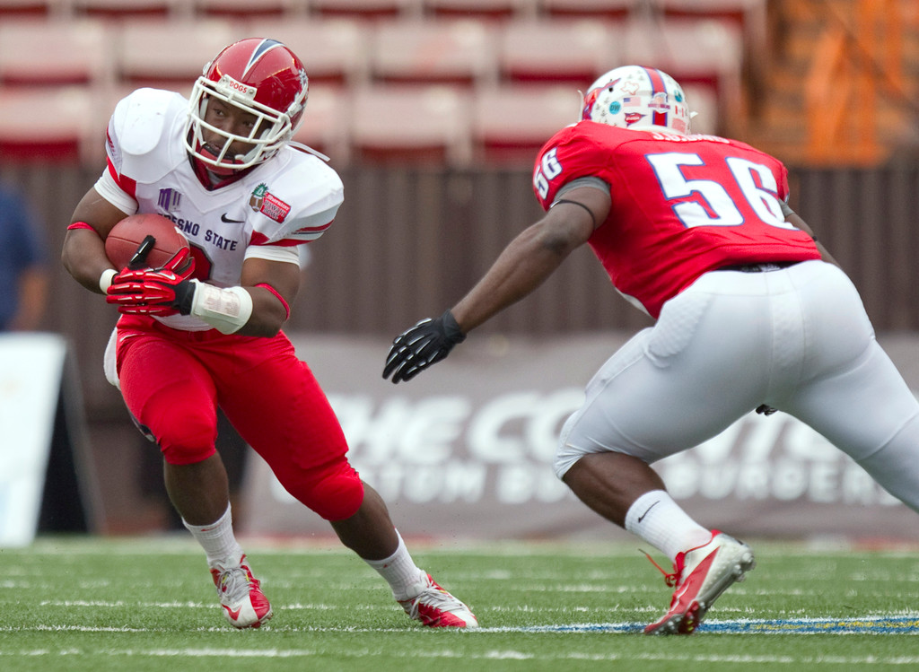 . Fresno State running back Robbie Rouse (8) cuts back away from SMU linebacker Ja\'Gared Davis (56) in the first quarter of the Hawaii Bowl NCAA college football game Monday, Dec. 24, 2012, in Honolulu. (AP Photo/Eugene Tanner)