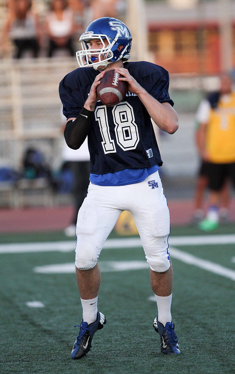 . San Marino\'s Andrew Ferraco (18) looks to pass during the 35th Annual Hall of Fame All-Star Football Game at West Covina High School in West Covina, CA on Friday, May 16, 2014. (Correspondent Photo by David Thomas for the Pasadena Star News)