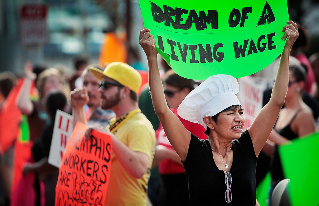 . Christina Condori joins a crowd of low-income fast food workers and their supporters in protest on Thursday, Aug. 29, 2013, while picketing outside of the McDonalds restaurant in Memphis, Tenn. (AP Photo/The Commercial Appeal, Jim Weber)