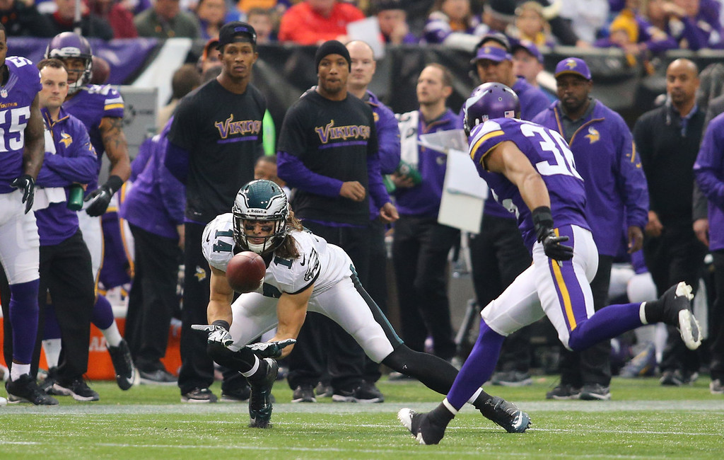. Riley Cooper #14 of the Philadelphia Eagles dives for a pass against the Minnesota Vikings on December 15, 2013 at Mall of America Field at the Hubert H. Humphrey Metrodome in Minneapolis, Minnesota. (Photo by Adam Bettcher/Getty Images)