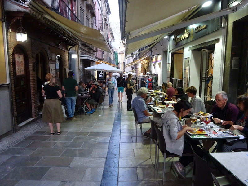 Great cafe life in Granada.  The tradition is, buy a drink, get a round of tapas for free.