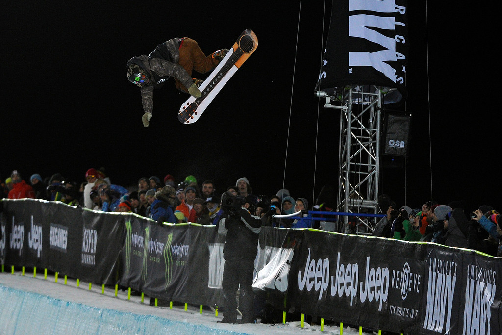 . Danny Davis catches air at the men\'s snowboard superpipe elimination in Aspen at Winter X Games in Aspen, January 22, 2014. The men\'s snowboard superpipe final will be held Sunday night on Buttermilk Mountain.