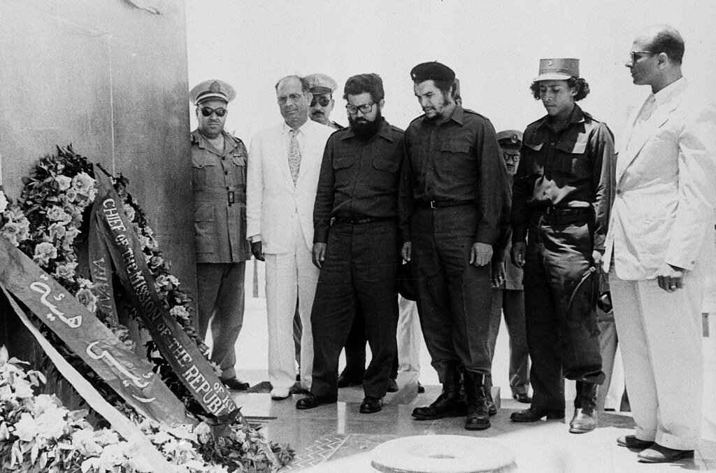 ". Commander Ernesto ""Che\"" Guevara (third from right), right hand man of Cuba\'s President Fidel Castro, and his party visit Port Said, Egypt, June 24, 1959, and lay wreaths at the Martyrs\' Monument.  At far right is Mahmoud Younes, chairman of the board of directors of the Suez Canal Authority.  Others are unidentified. (AP Photo)"