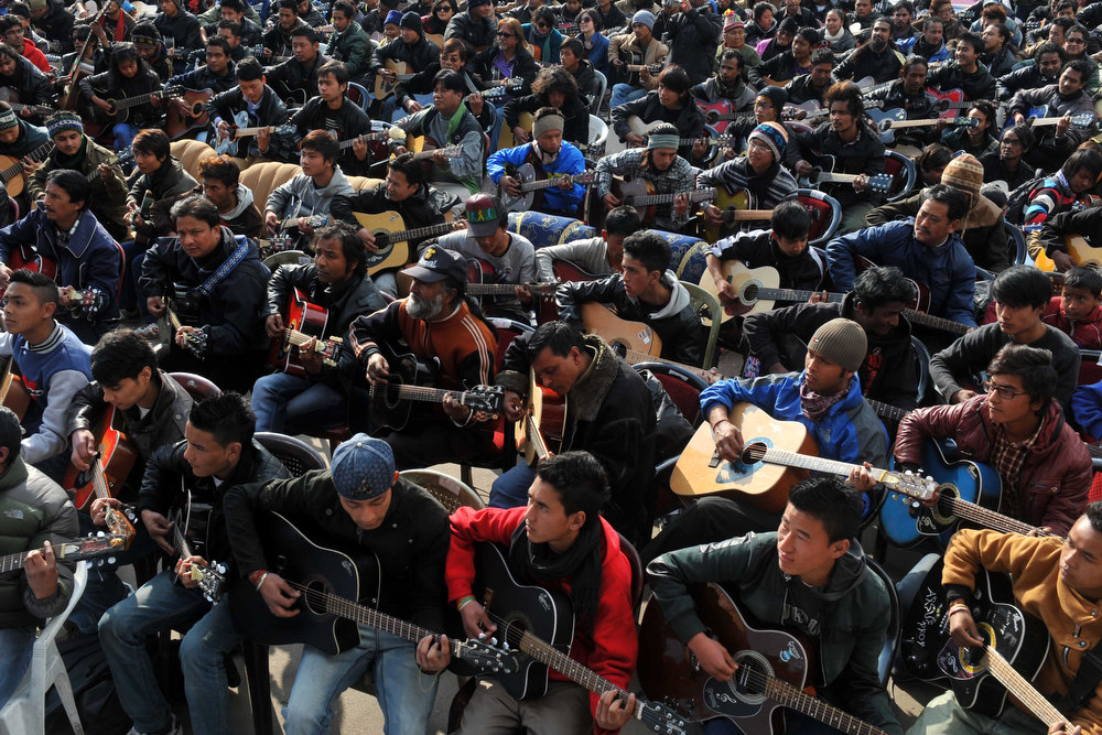 ". Musicians play John Lennon\'s ""Imagine\"" in a memorial tribute to the 23-year old Indian gang rape victim, during a mass guitar ensemble played by some 600 guitarists in Darjeeling on January 3, 2013. Protesters have massed in Indian cities daily since the December 16 assault demanding the government and police take sex crime more seriously, with tougher penalties for offenders and even chemical castration being considered. Five men accused of gang-raping a 23-year-old student on a moving bus in New Delhi in a deadly crime that repulsed the nation are to be formally charged in court January 3.  DIPTENDU DUTTA/AFP/Getty Images"