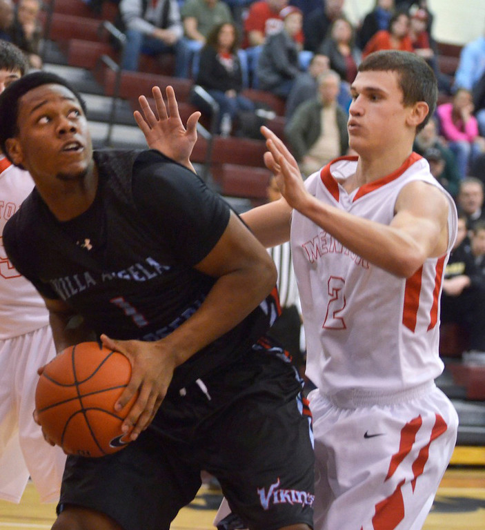 . Jeff Forman/JForman@News-Herald.com Brian Parker, VASJ, looks to shoot as Kyle Hagey, Mentor, defends during VASJ\'s 82-71 win over Mentor Sunday in the Dunk4Diabetes Shootout at Walsh University in North Canton.