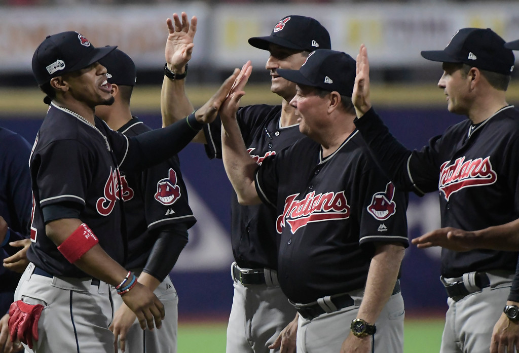 . Cleveland Indians\' Francisco Lindor, left, enters the field moments before the first inning against The Minnesota Twins during game one of a two-game MLB Series at Hiram Bithorn Stadium in San Juan, Puerto Rico, Tuesday, April 17, 2018. (AP Photo/Carlos Giusti)