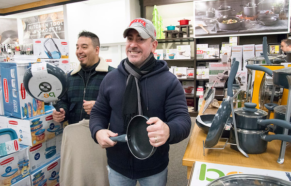 11/29/19 Wesley Bunnell   StaffrrHelping to pick out a frying pan during the Kohl's Black Friday sales event are Emmanuel Berger, L, and Brian Berger. This marks the fifth year where the group of immediate family and friends kicks off the holiday season with a Black Friday shopping trip to Kohl's in Plainville followed up with a movie.