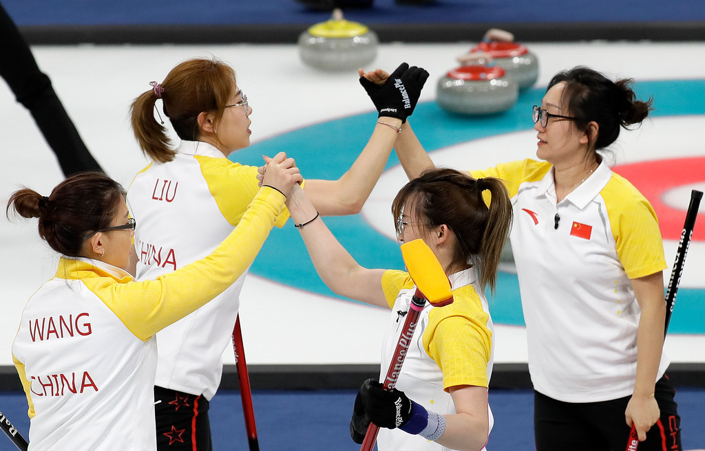 . China\'s women curling team celebrate after winning their match against Japan at the 2018 Winter Olympics in Gangneung, South Korea, Saturday, Feb. 17, 2018. (AP Photo/Aaron Favila)