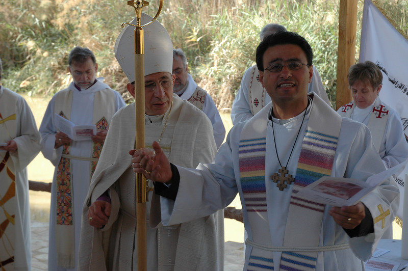 Pastor Samer Azar, right, Good Shepherd Evangelical Lutheran Church, Amman, Jordan, reads the liturgy at a worship service at the site of Jesus' baptism in Jordan Jan. 6.  With him is ELCJHL Bishop Munib Younan.