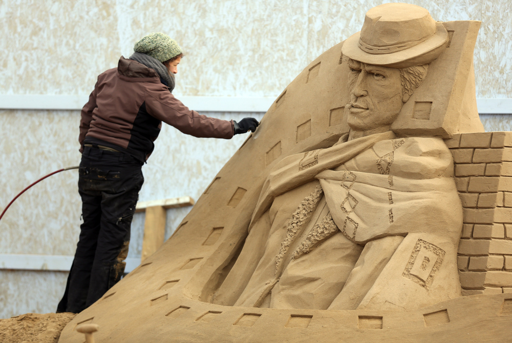 Description of . A sand sculptor works on a Clint Eastwood sand sculpture as pieces are prepared as part of this year's Hollywood themed annual Weston-super-Mare Sand Sculpture festival on March 26, 2013 in Weston-Super-Mare, England. Due to open on Good Friday, currently twenty award winning sand sculptors from across the globe are working to create sand sculptures including Harry Potter, Marilyn Monroe and characters from the Star Wars films as part of the town's very own movie themed festival on the beach.  (Photo by Matt Cardy/Getty Images)