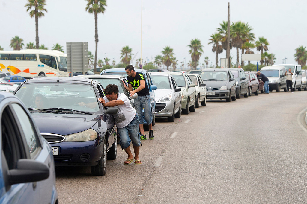 . Motorists queue on August 13, 2013 at the border crossing between Spain and Gibraltar in La Linea de la Concepcion. Irate drivers waited up to five hours to enter Gibraltar today, some even pushing their cars to save fuel, as Spain enforced tight border checks in a growing row with Britain over the tiny territory and its surrounding waters. The latest flare-up was sparked when Gibraltar sank concrete blocks in disputed waters to create an artificial reef, making it impossible for Spanish fishing fleets to operate in the area.   MARCOS MORENO/AFP/Getty Images