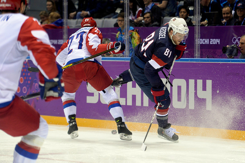 . Phil Kessel (81) of the U.S.A. and Alexei Tereshenko (27) of the Russia collide during  the third period of the U.S.A.\'s win at Bolshoy arena. Sochi 2014 Winter Olympics on Saturday, February 15, 2014. (Photo by AAron Ontiveroz/The Denver Post)