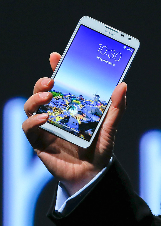 . Huawei Consumer Business Group CEO Richard Yu holds up the Ascend Mate 2 4G smartphone at a news conference during the International Consumer Electronics Show, Monday, Jan. 6, 2014, in Las Vegas. (AP Photo/Julie Jacobson)