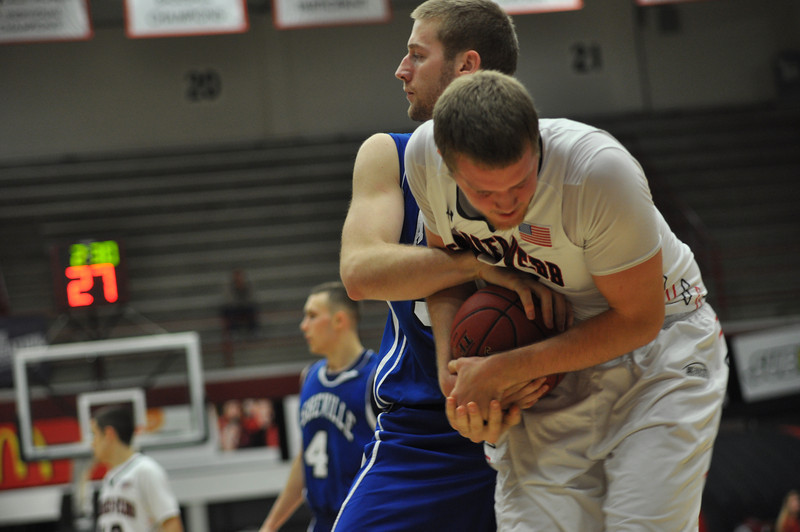 GWU Logan Stumpf holds on to gain a jump ball against UNC Asheville