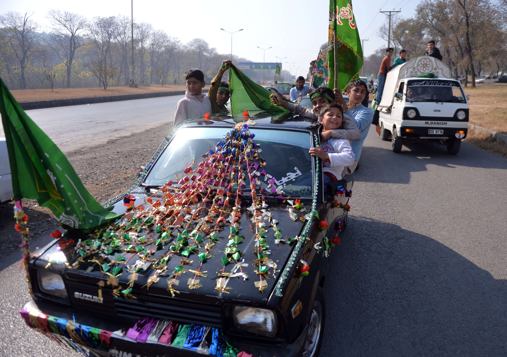 . Pakistani Muslims parade during celebrations marking Eid Milad-un-Nabi, the birthday of Prophet Mohammed in Islamabad on January 14, 2014. Muslims across the world celebrated the birth of the Prophet Mohammed 12 Rabil ul Awal, a month of the Muslim calendar.  (AAMIR QURESHI/AFP/Getty Images)