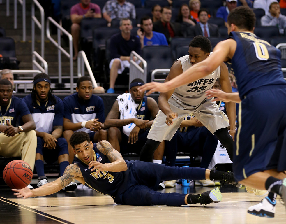 . Cameron Wright #3 of the Pittsburgh Panthers dives for a loose ball against the Colorado Buffaloes in the first half during the second round of the 2014 NCAA Men\'s Basketball Tournament at Amway Center on March 20, 2014 in Orlando, Florida.  (Photo by Mike Ehrmann/Getty Images)